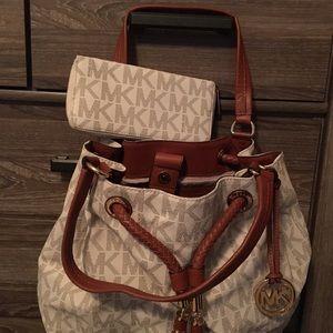 Michael Kors - handbag and matching wallet.